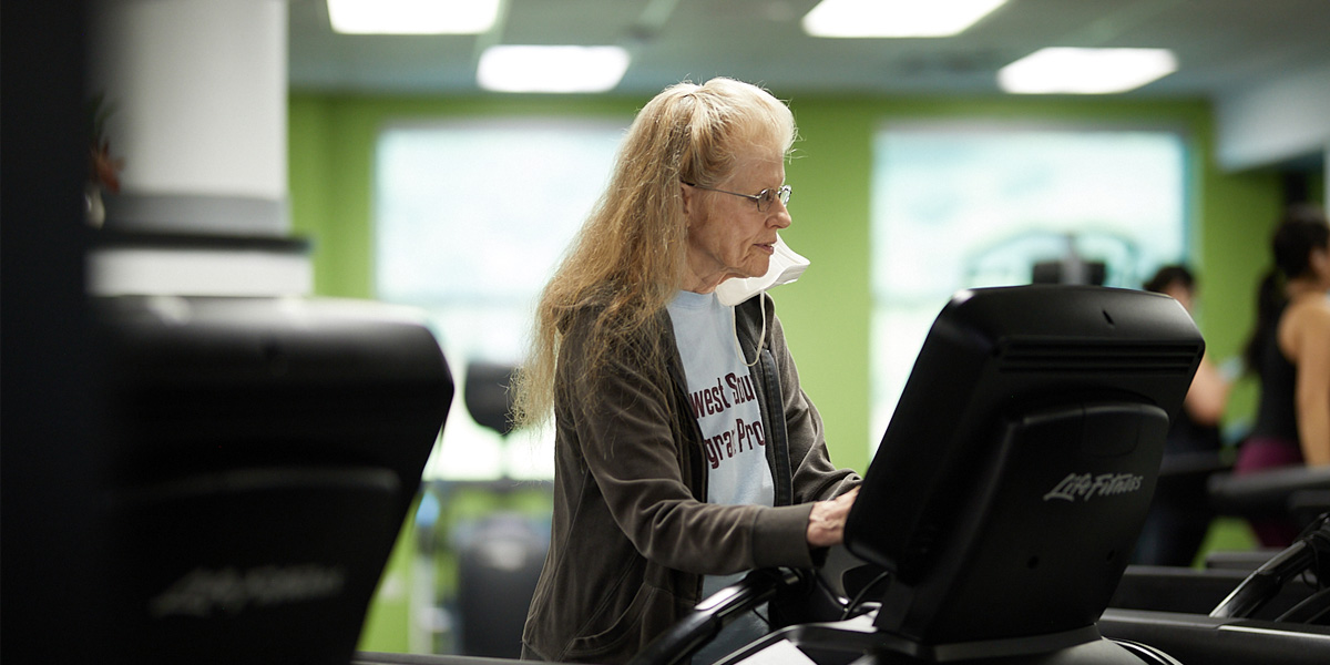middle-aged white woman working out on treadmill